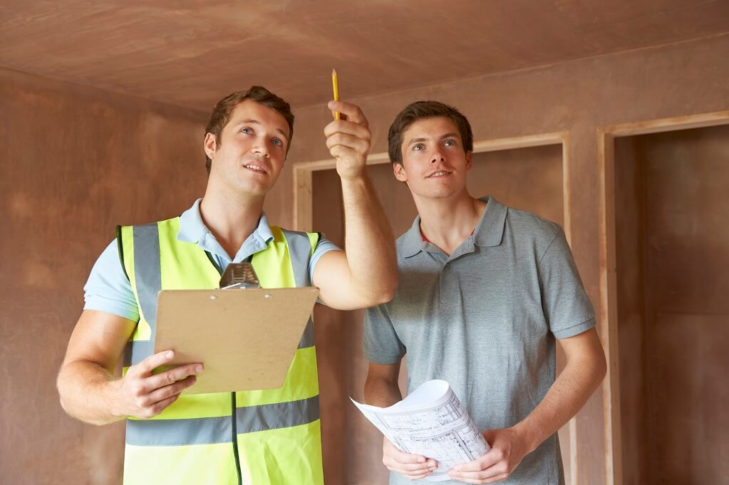builder-and-inspector-looking-at-new-property